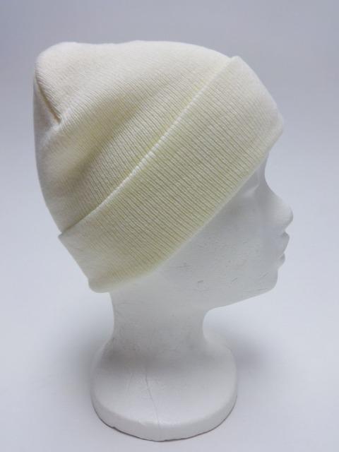 Cremefarbene Mütze mit Manschette